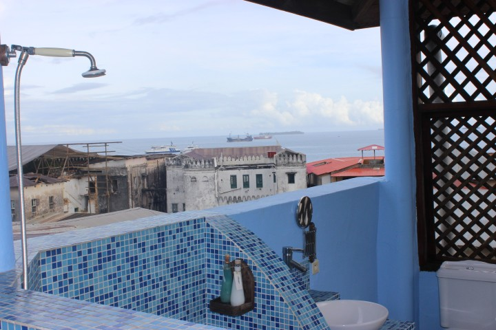 My shower and sink, with a view to the sea. It's open air but I have complete privacy.